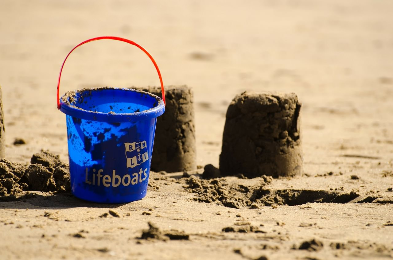 Sandcastles and bucket on beach